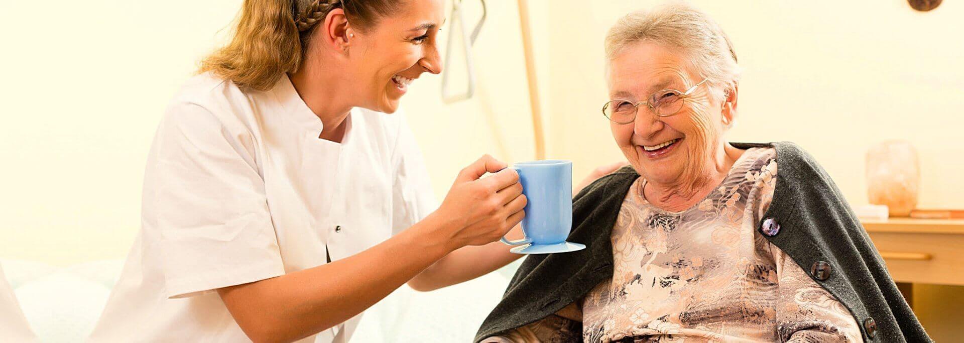 caregiver attending her patient